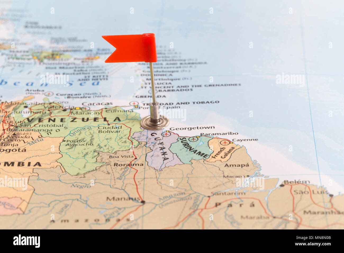 Where Is Guyana Located On The World Map.Small Red Flag Marking The African Country Of Guyana On A World Map