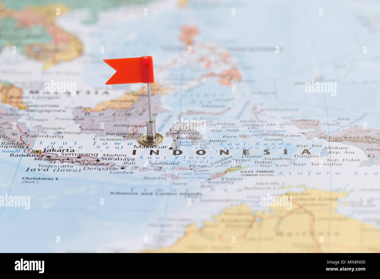 Small red flag marking indonesia on a world map stock photo small red flag marking indonesia on a world map gumiabroncs Image collections