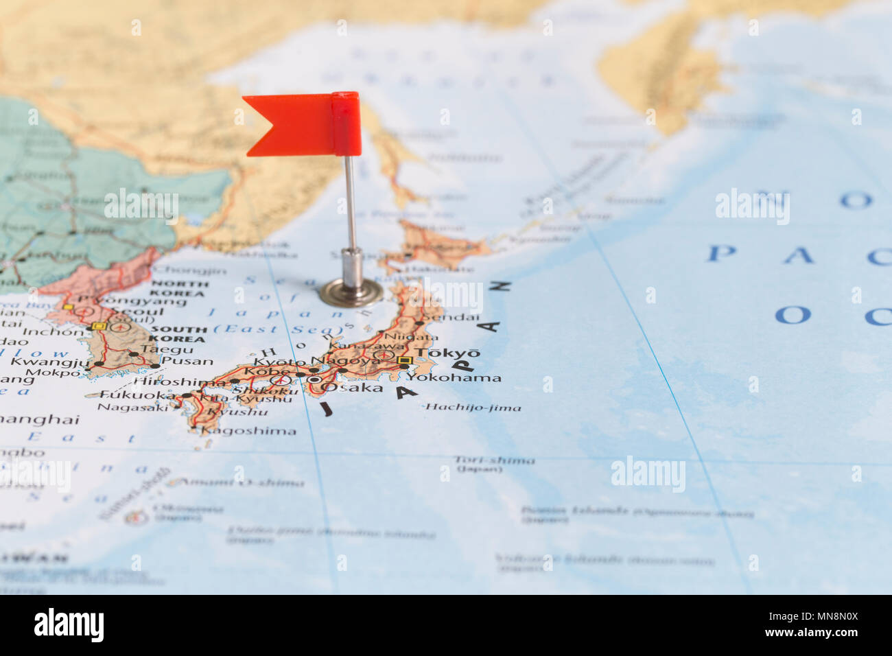 Small red flag marking Japan on a world map Stock Photo ...