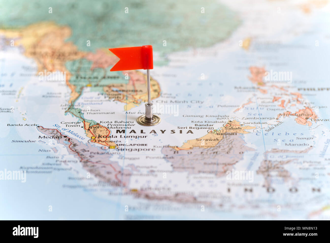 Small Red Flag Marking The African Country Of Malaysia On A World