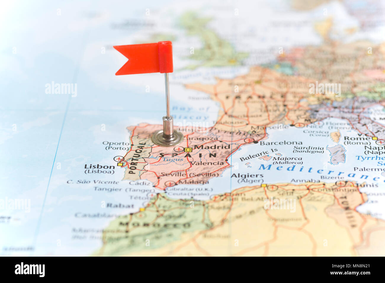 Small Map Of Spain.Small Red Flag Marking The European Country Of Spain On A World Map