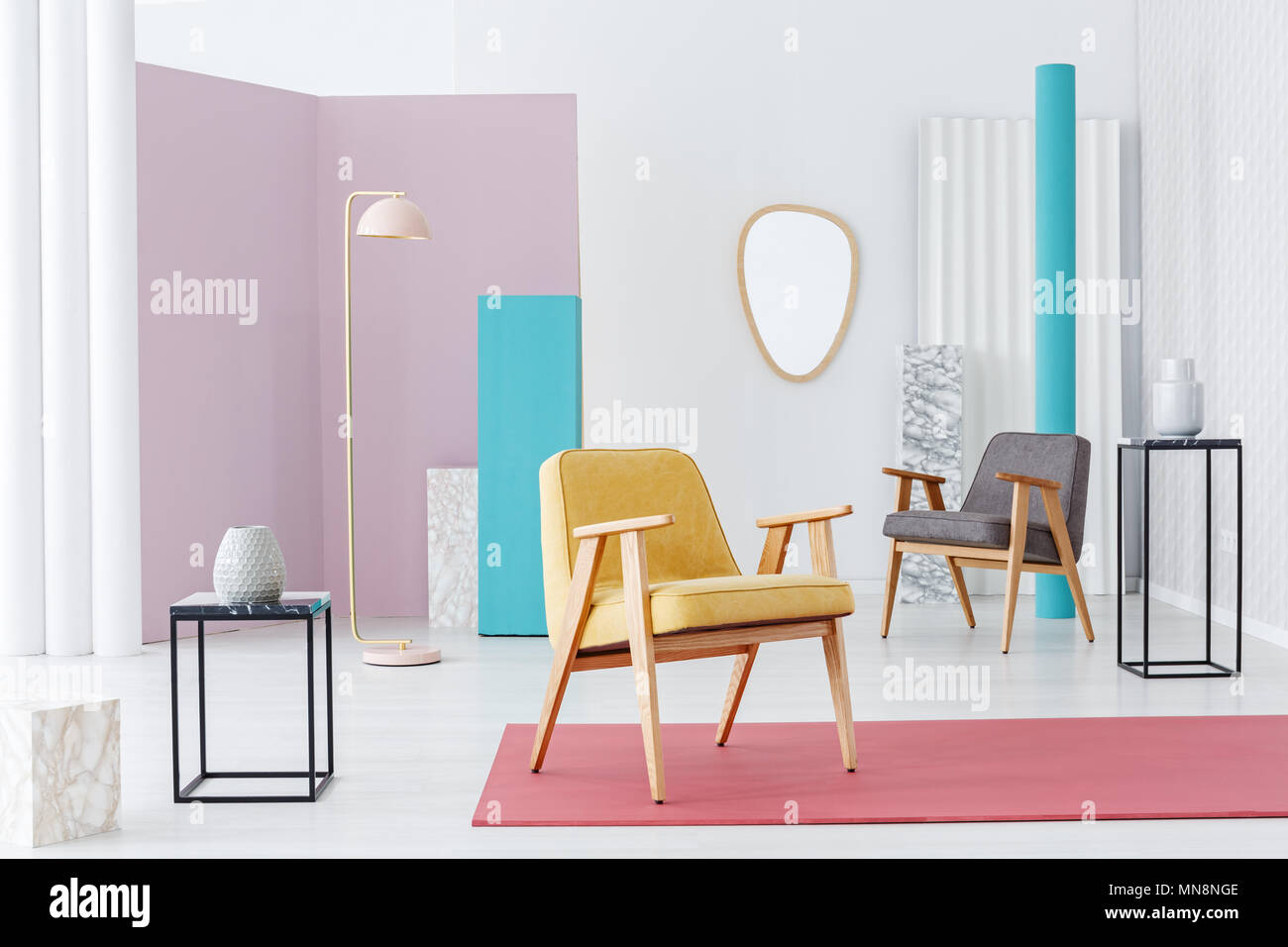 yellow wooden armchair on pink rug in pastel retro living room rh alamy com