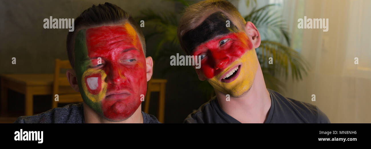 Spain and German football fans with painted faces Stock Photo