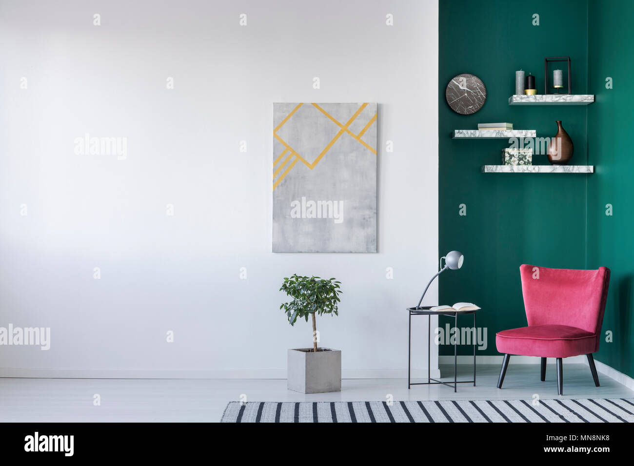 Minimalist Interior In White And Green With Red Armchair Lamp And
