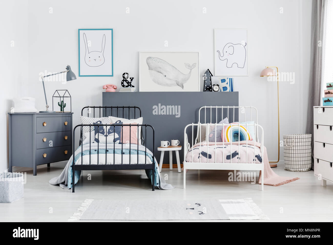 Black And White Beds In Colorful Kids Bedroom Interior With Posters And Lamp On Cabinet Real Photo Stock Photo Alamy