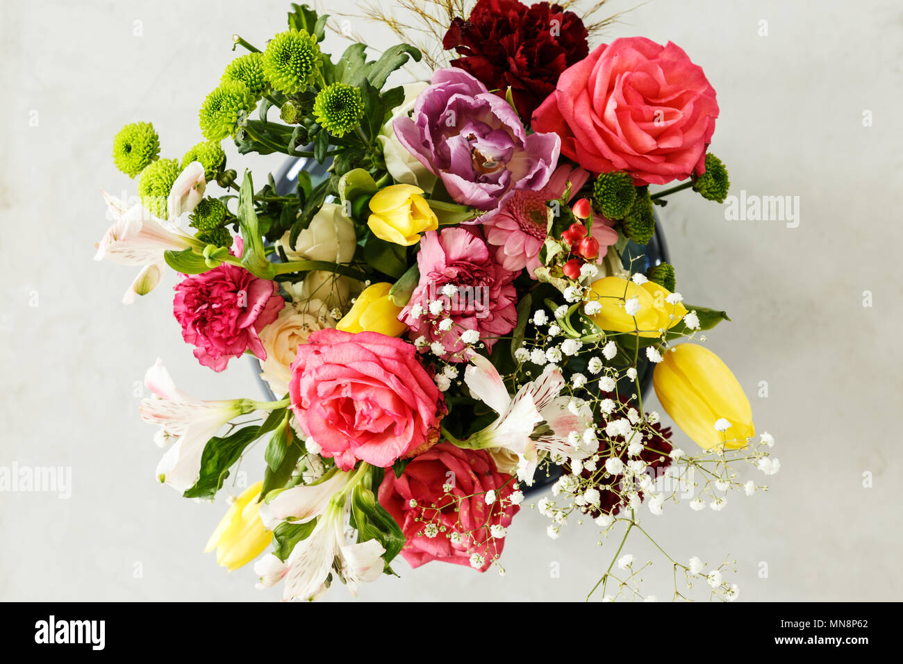 Top view of colorful bouquet of spring flowers pink roses and top view of colorful bouquet of spring flowers pink roses and yellow tulips on a gray background izmirmasajfo
