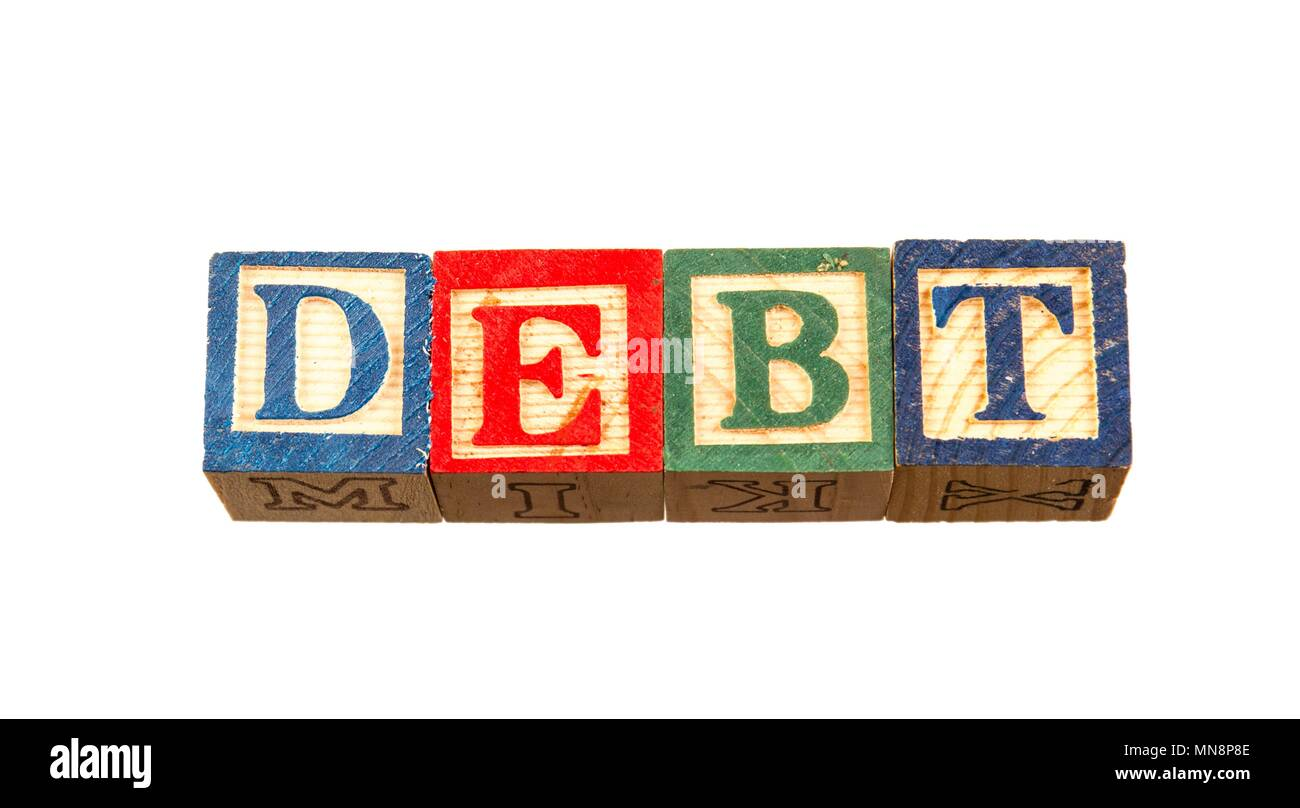 The term debt visually displayed on a white background using colorful wooden toy blocks image in landscape format with copy space - Stock Image