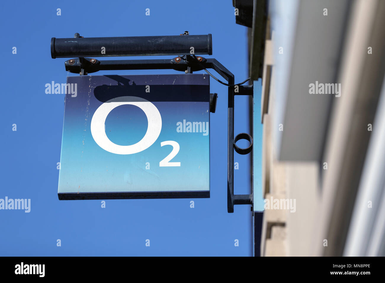 A branch of mobile phone and communications provider O2 in the United Kingdom, O2 logo. - Stock Image