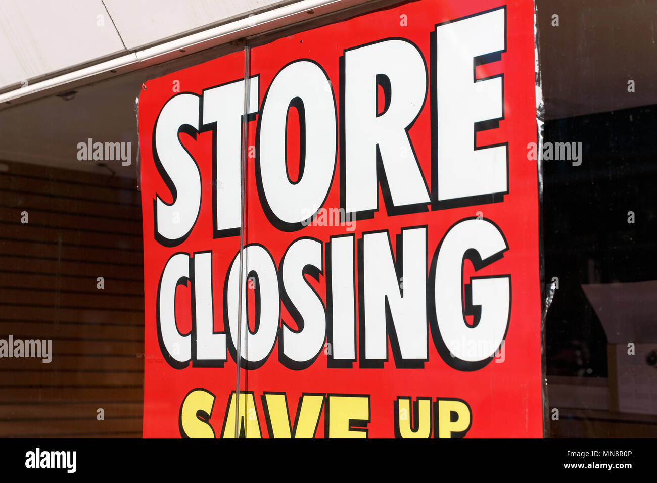 A high street retailer advertising a store closing down sale. - Stock Image