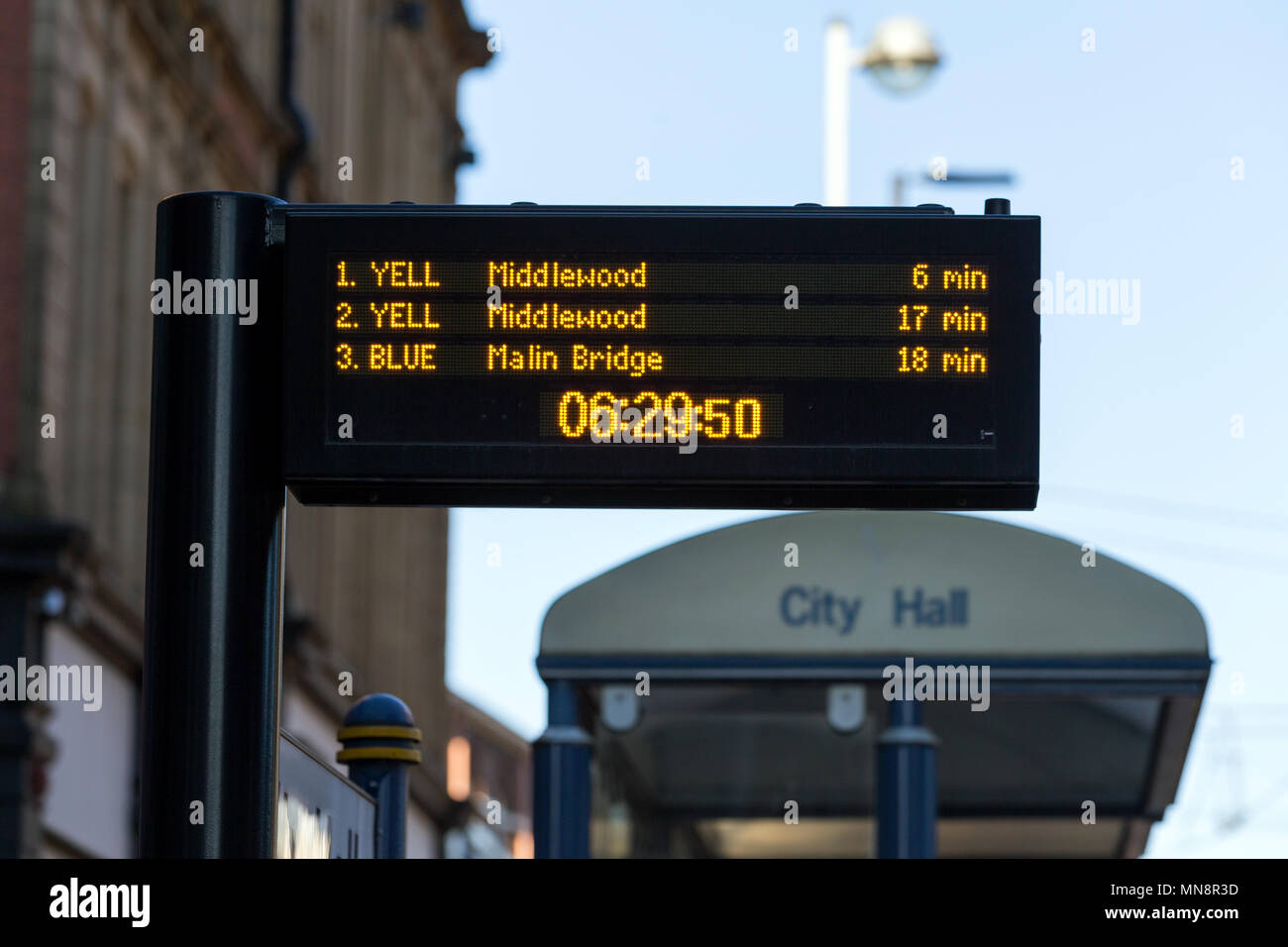 A digital display at a tram stop in Sheffield, South Yorkshire, UK. - Stock Image