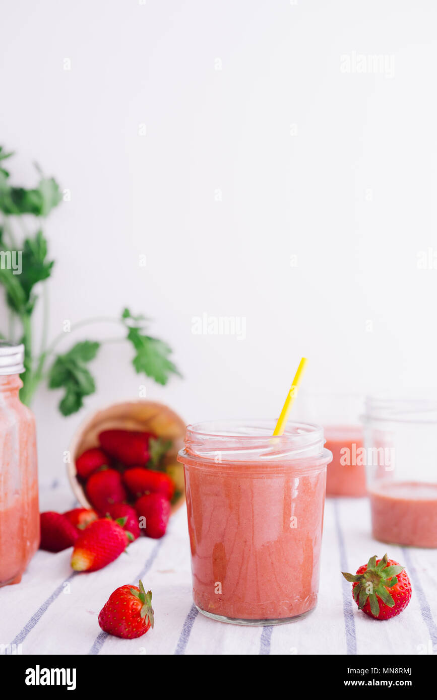 Healthy smoothie with strawberries over a white background. Detox, diet, healthy, vegetarian food concept with copy space. - Stock Image