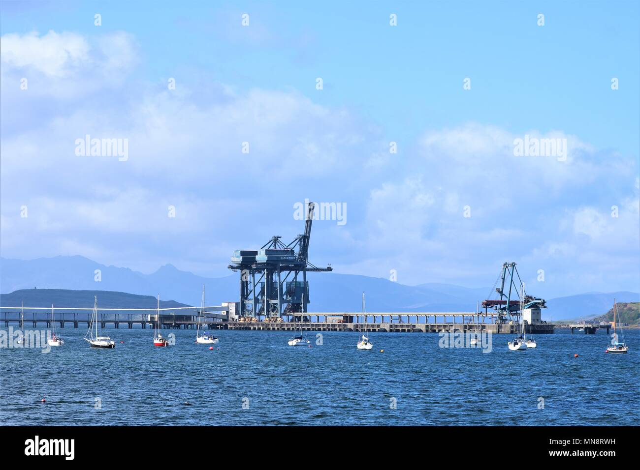 Cranes / ship loaders for unloading coal for Hunterston A Power Station at Clydeport Terminal, Largs, North Ayrshire, Scotland, UK - Stock Image