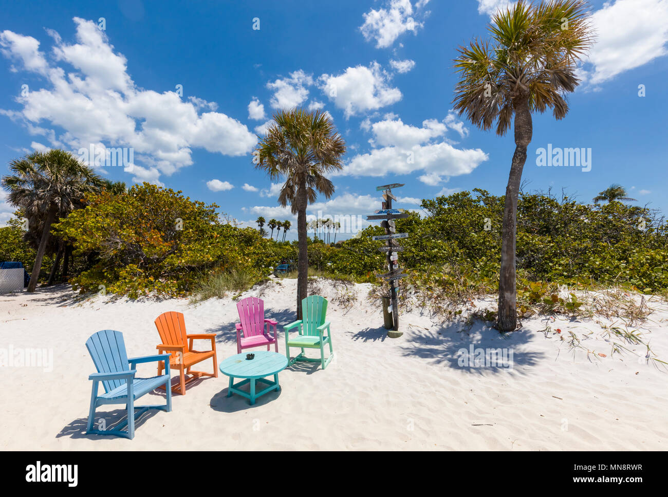 Colorful chairs on the Gulf of Mexico beach at the South Beach Bar & Grill in Boca Grande on Gasparilla Island Florida - Stock Image