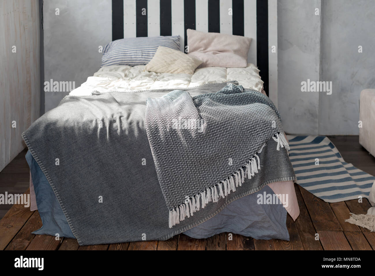 Modern Bedroom With Simple Furniture Gray Bedding And Wooden Headboard Modern Apartment Interior In Loft Design Bed With Pillows Stock Photo Alamy