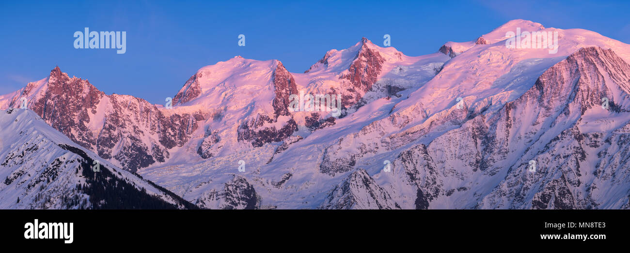 Mont Blanc mountain range at sunset in Upper Savoy. From left to right, Aiguille du Midi needle, Mont Blanc du Tacul, Mont Maudit, Mont Blanc and Dome - Stock Image