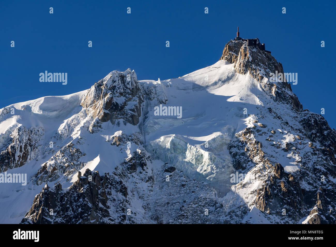 Aiguille du Midi needle in winter morning light. Chamonix Mont Blanc, Haute-Savoie (Upper Savoy) - Stock Image