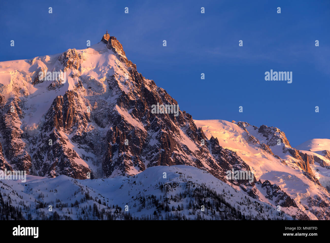 Aiguille du Midi needle at sunset with view on the glaciers of the Mont Blanc mountain range. Chamonix, Haute-Savoie (Upper Savoy), Alps, France - Stock Image