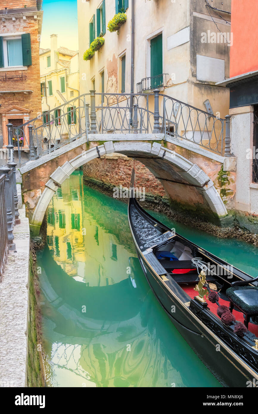 Venice canal with gondola, Venice, Italy, Vintage processed. - Stock Image