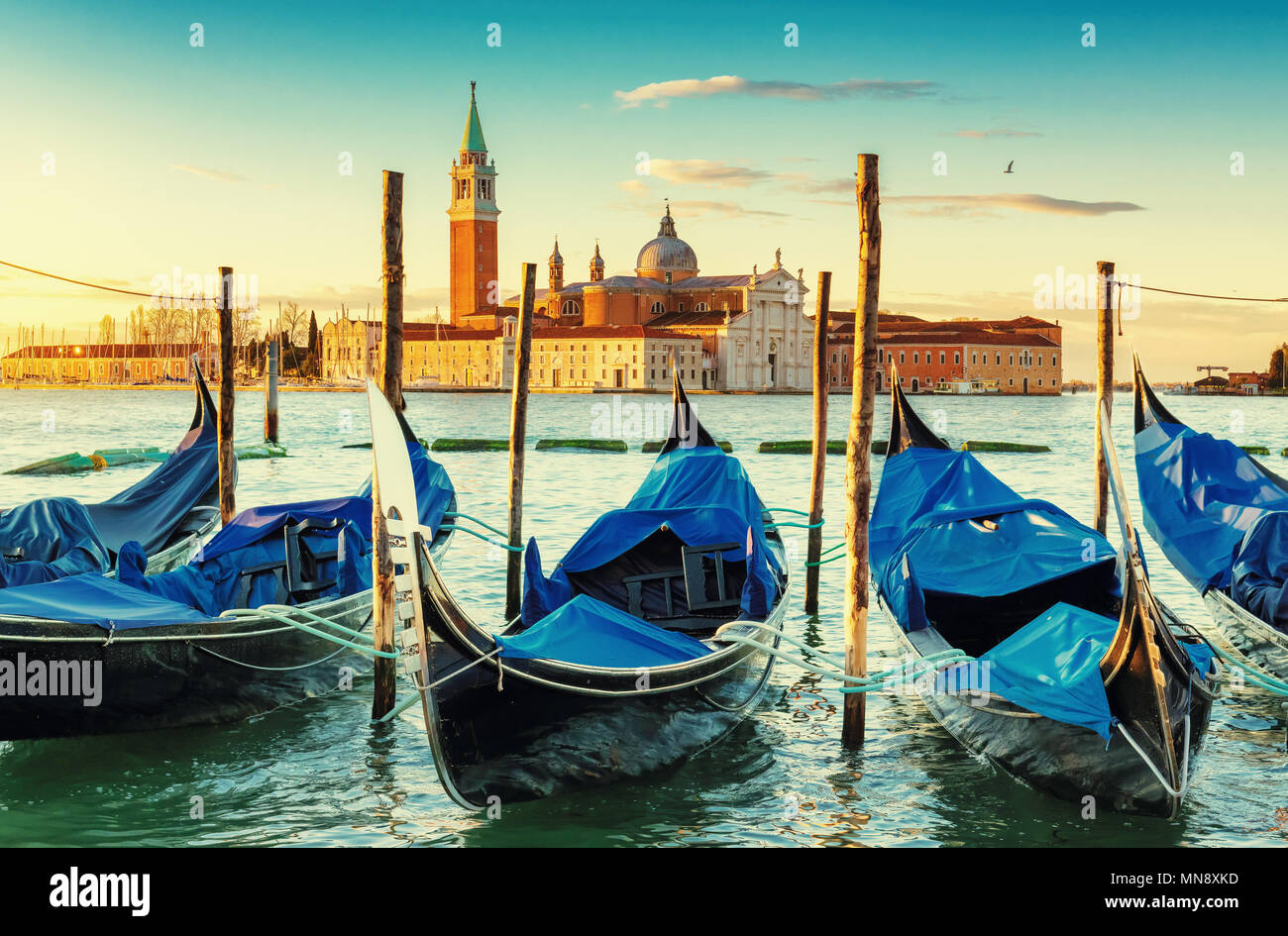 Venice gondolas near San Marco square at sunrise, Grand Canal, Venice, Italy. Vintage post processed. Stock Photo