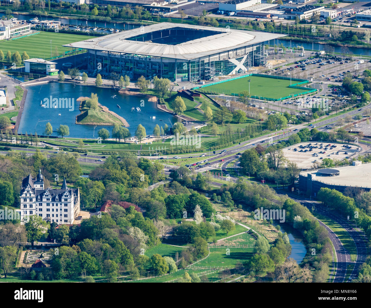 Castle Wolfsburg and Volkswagen Arena, stadium, Wolfsburg, Lower-Saxony, Germany - Stock Image