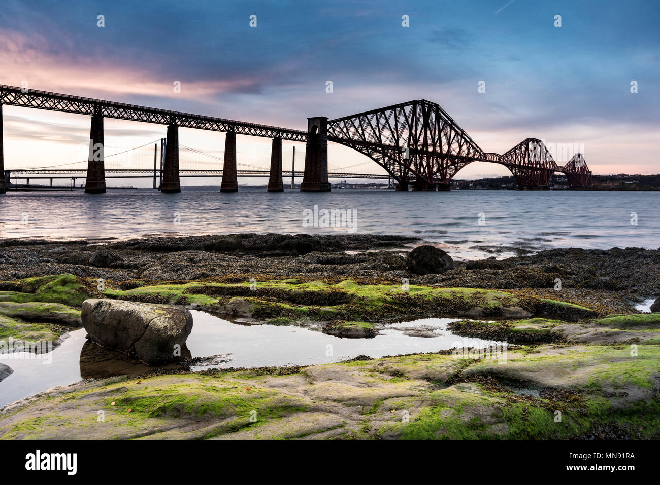 An old historic rail bridge in Queensferry near Edinburgh in Scotland before sunset - Stock Image