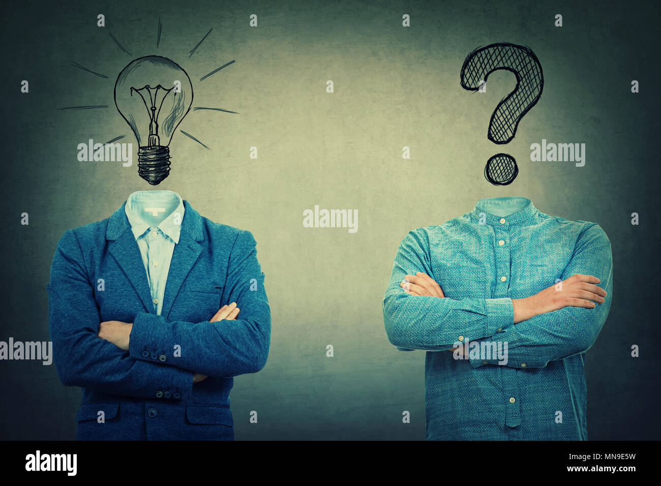 Two crossed hands businessmans with drawn bulb and interrogation mark instead of head. Problem and solution concept. - Stock Image