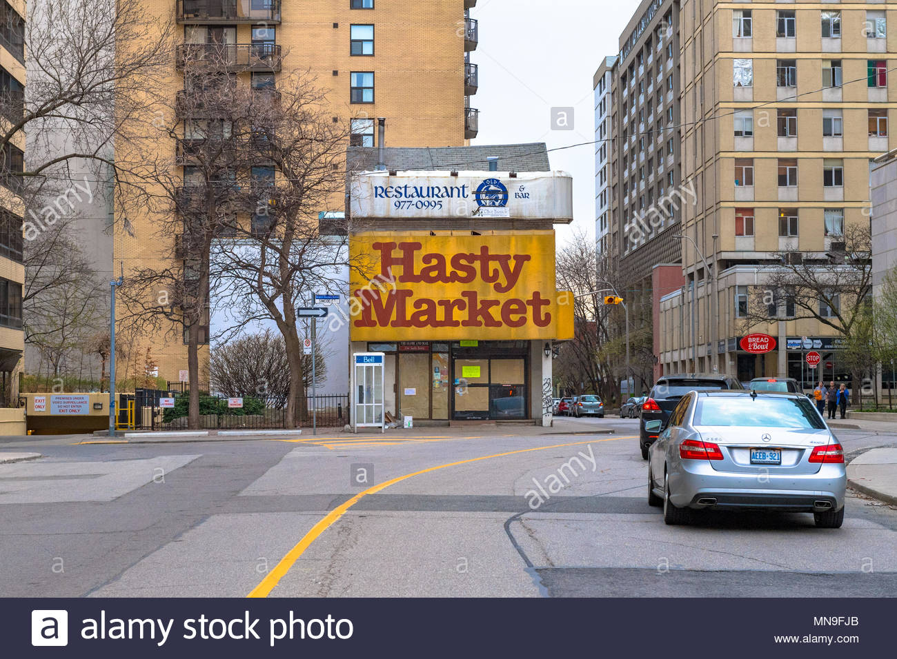Hasty Market old building contrasting with the tall buildings in the downtown district - Stock Image
