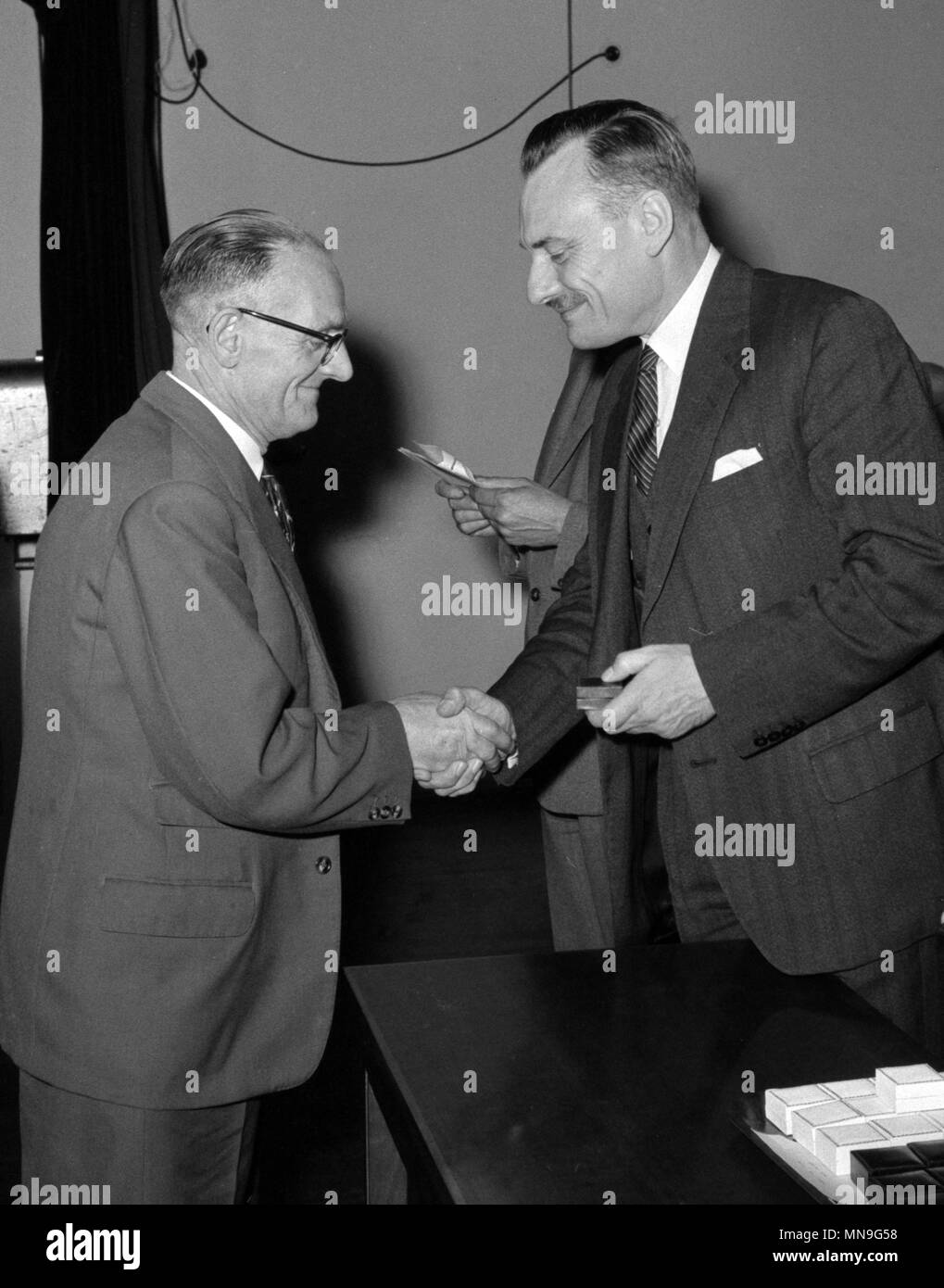 Mr E. Goodyear, of Hunslet Hall Road, Leeds, receives his silver-gilt badge from Minister of Health, Enoch Powell, at a presentation of long-service awards to donors to the National Blood Transfusion Service at the Ministry in London. The silver-gilt badge was awarded to Mr Goodyear, who became a donor in 1941, for giving 50 or more blood donations. - Stock Image