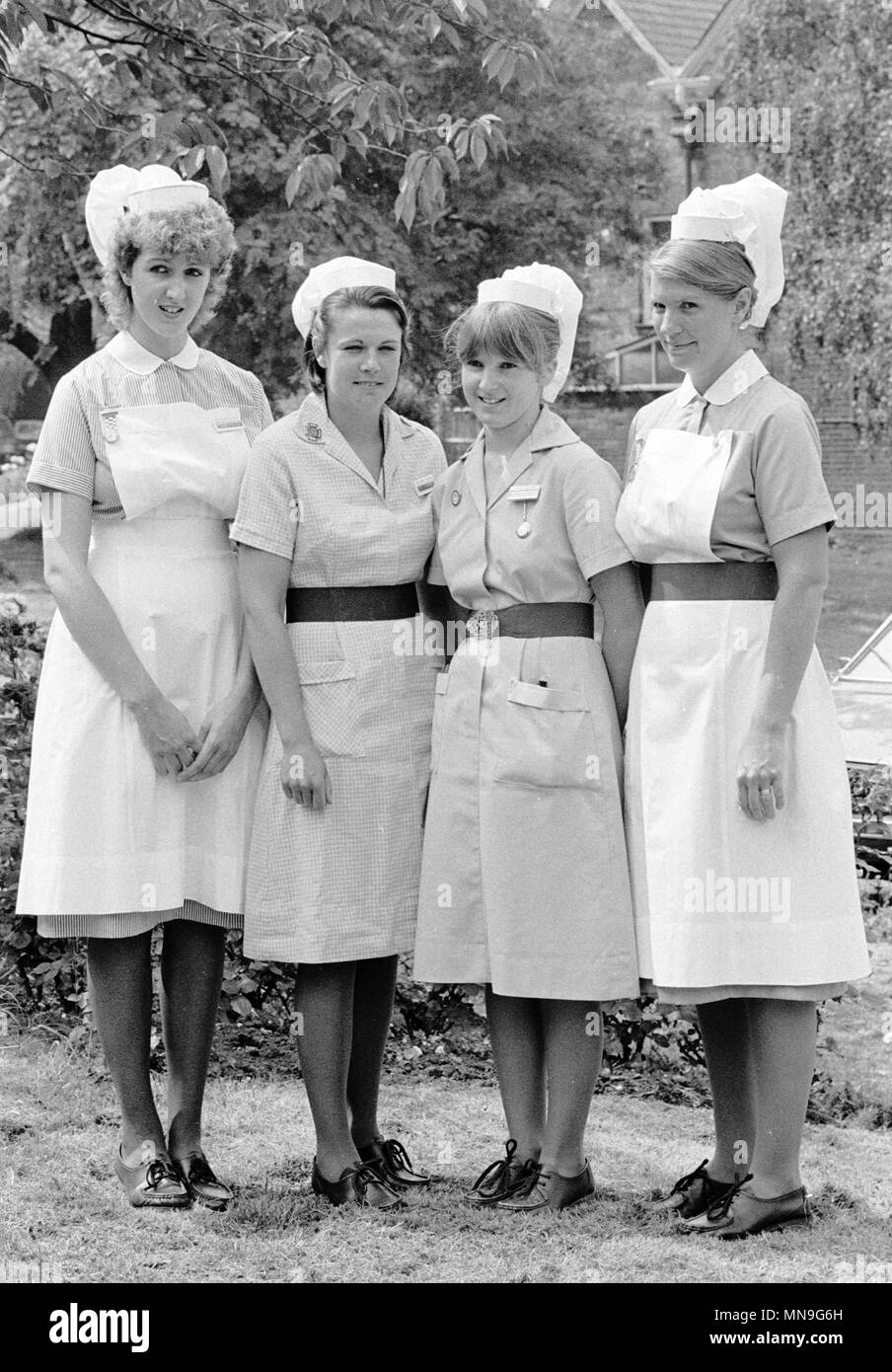 Fashion-conscious nurses working under the Merton and Sutton (Surrey) Health Authority have  designed a new uniform for themselves because they are fed up with the current drab uniform. The current uniform is worn by Student Nurse Karen Tapp (second left) and Staff Nurse Julia Peters (second right); while Student Nurse Sue Cross (l) and Staff Nurse Susan Sowden (r) wear the new uniform for their respective grades at Queen Mary's Hospital for Children in Carshalton, London. - Stock Image