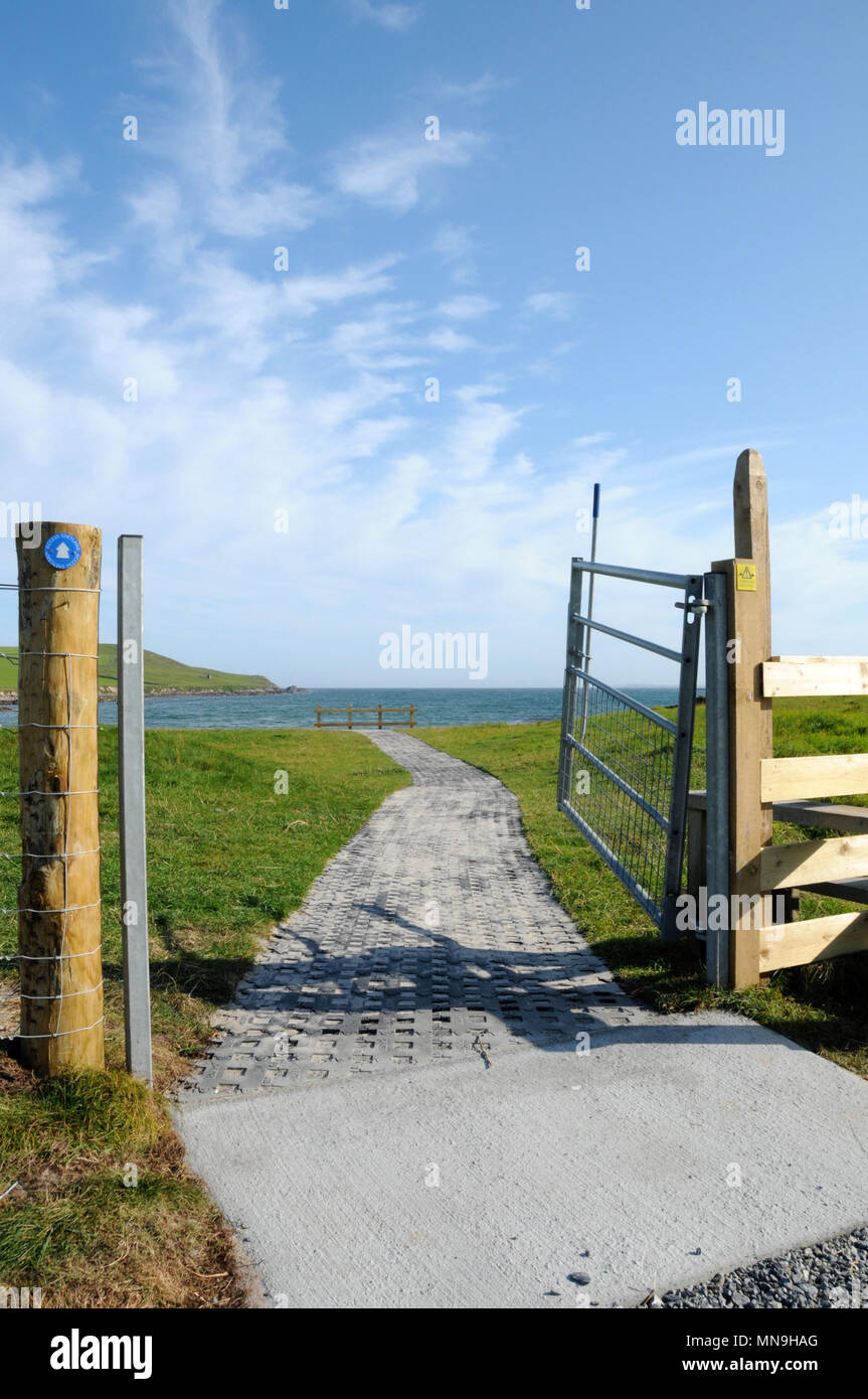 Sunny day and an open all access footpath to the beach for anyone with a disability - Stock Image