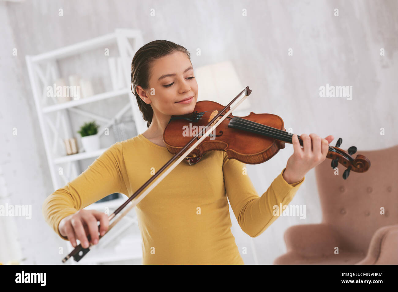 Attentive musician looking at strings - Stock Image