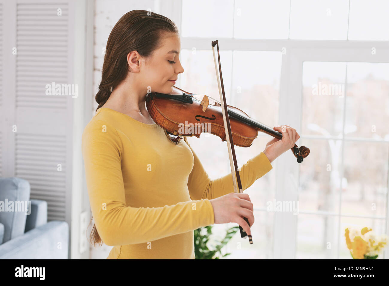 Attentive female person practicing new work - Stock Image