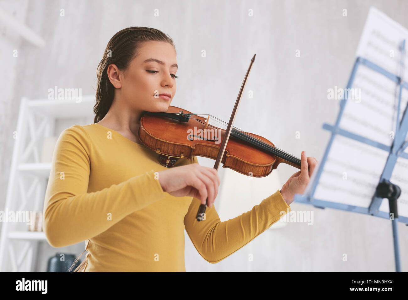 Concentrated musician playing serious work - Stock Image