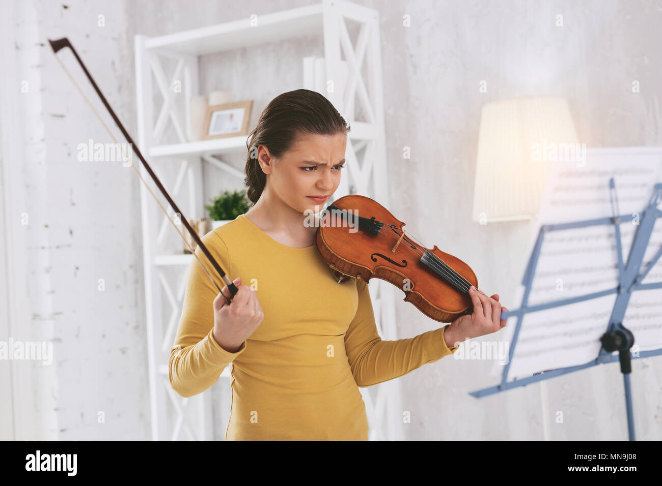 Angry girl looking at notes - Stock Image