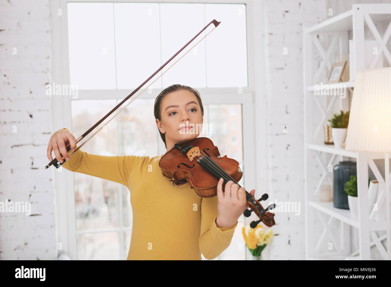 Professional musician dreaming about concert - Stock Image