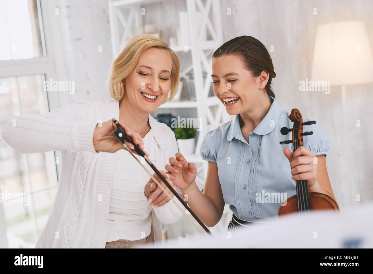 Positive delighted females spending lesson with pleasure - Stock Image