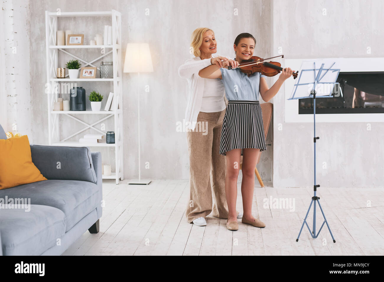 Delighted females enjoying classical music - Stock Image