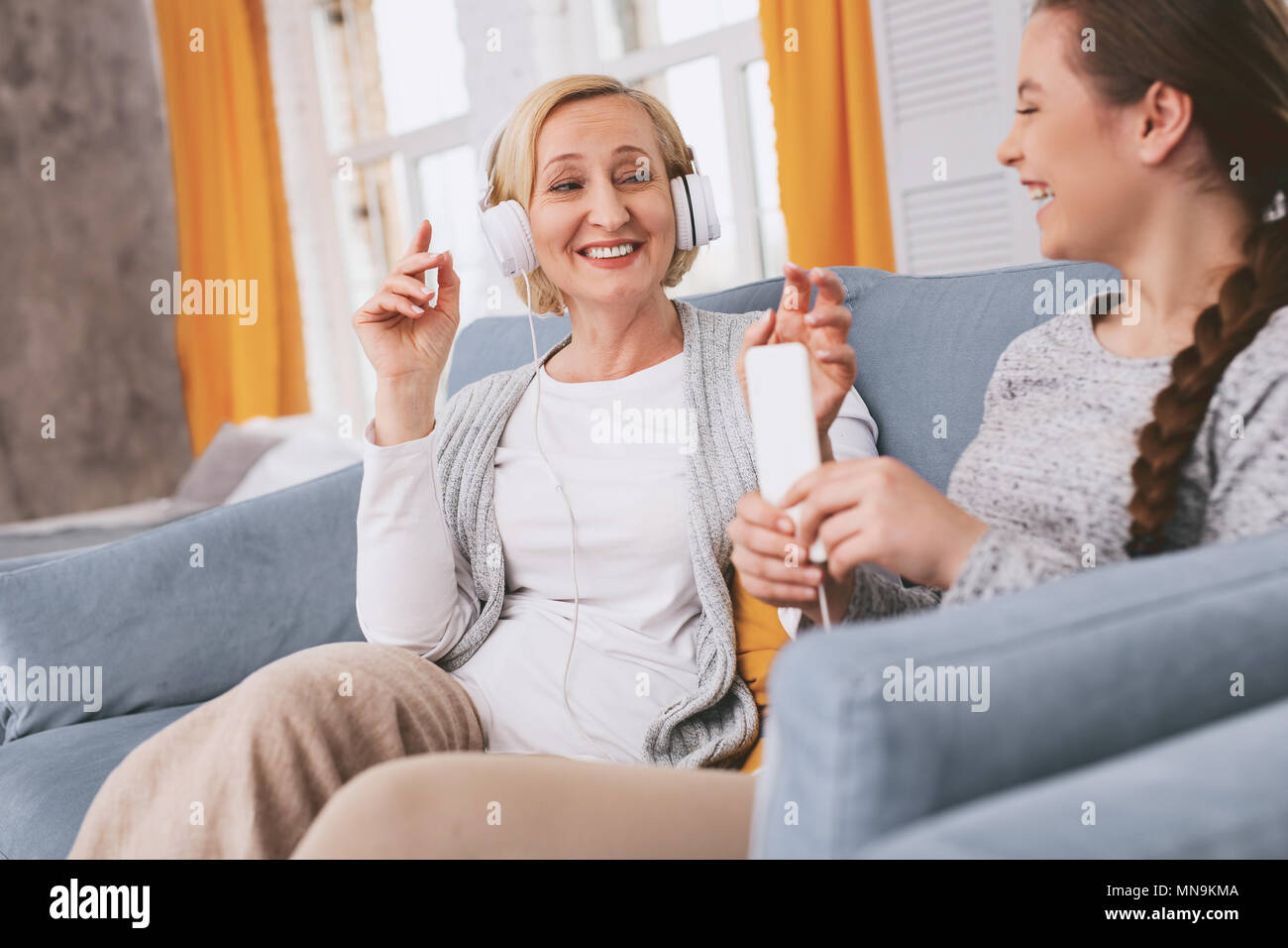 Pleased female person enjoying her weekends - Stock Image