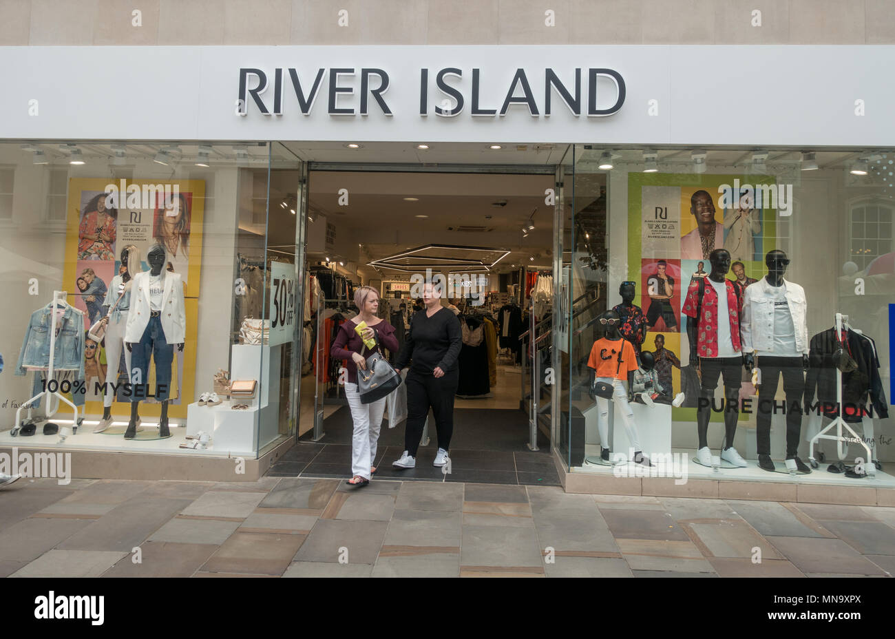 People shopping at UK highstreet shop River Island Stock Photo