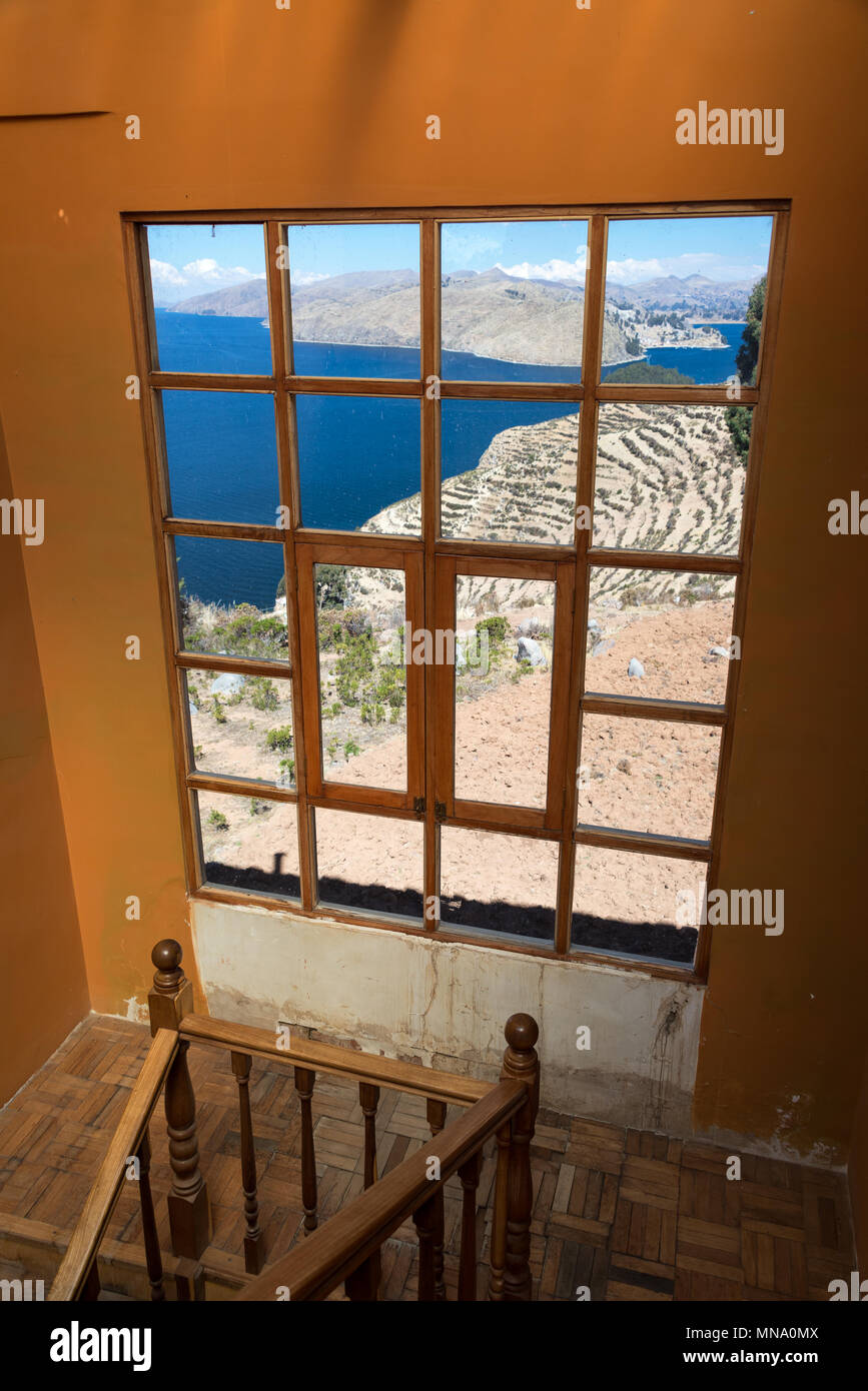 View of Isla del Sol and Lake Titicaca as seen through a window in Bolivia - Stock Image