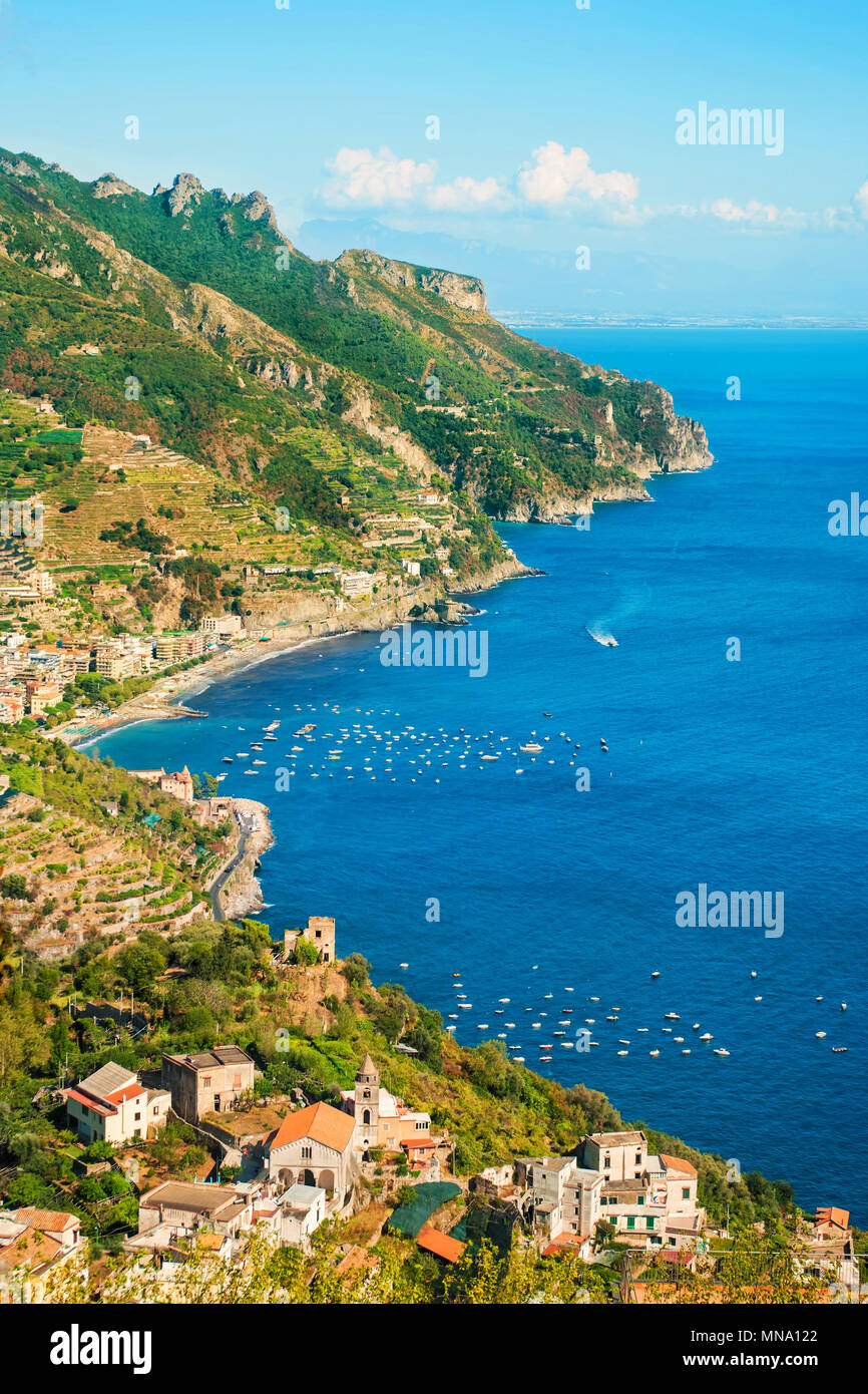 aerial view of small italian coastal towns surrounded by mountains in warm evening sun, Amalfi coast, Salerno, Campania, Italy Stock Photo