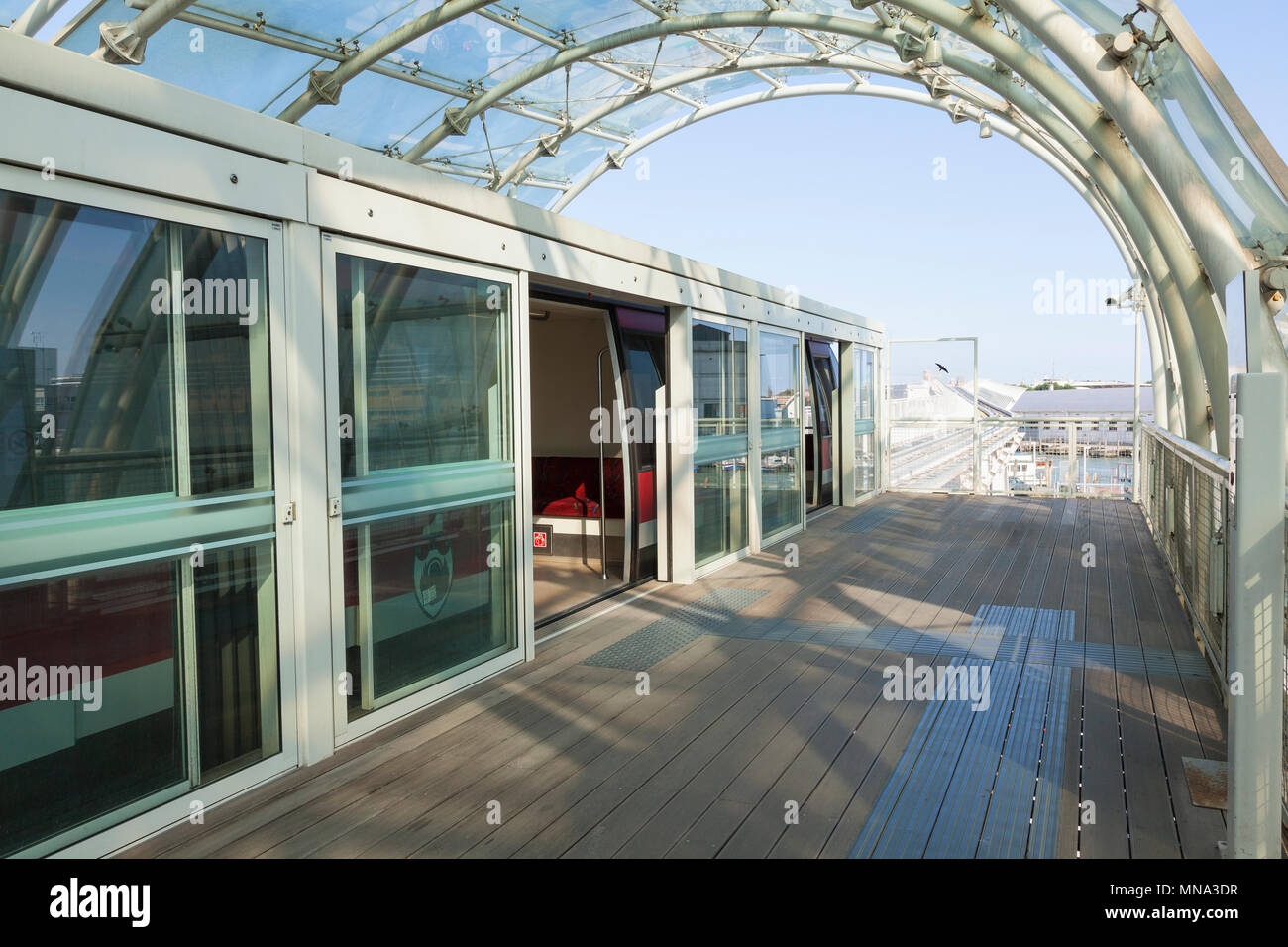 Venice People Mover Series: The Tronchetto ternimal interior with waiting Venice People Mover,  Venice, Italy with a view back to Venice Cruise termin - Stock Image