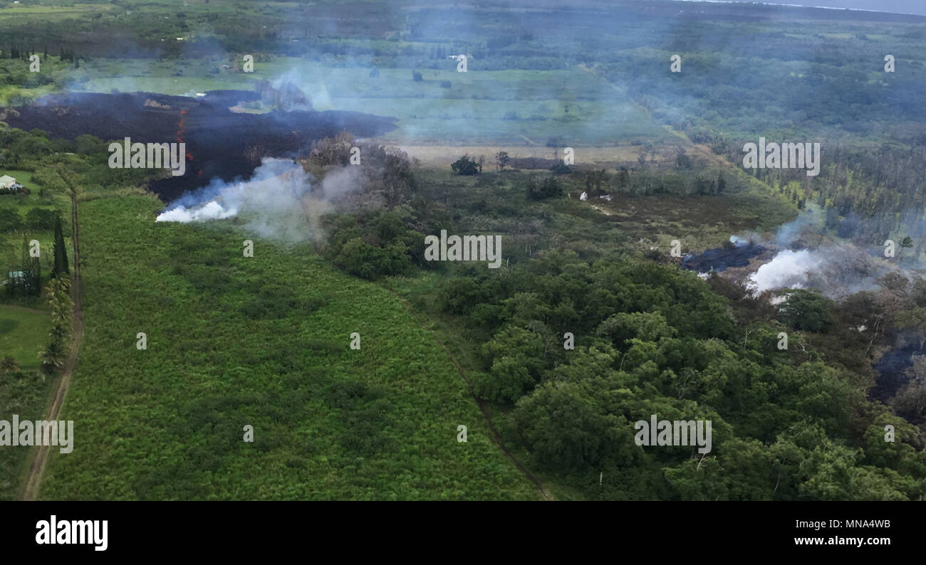 Aerial view of fissure 17 caused by the Kilauea volcano May 13, 2018 in Hawaii. The recent eruption continues destroying homes, forcing evacuations and spewing lava and poison gas on the Big Island of Hawaii.Stock Photo