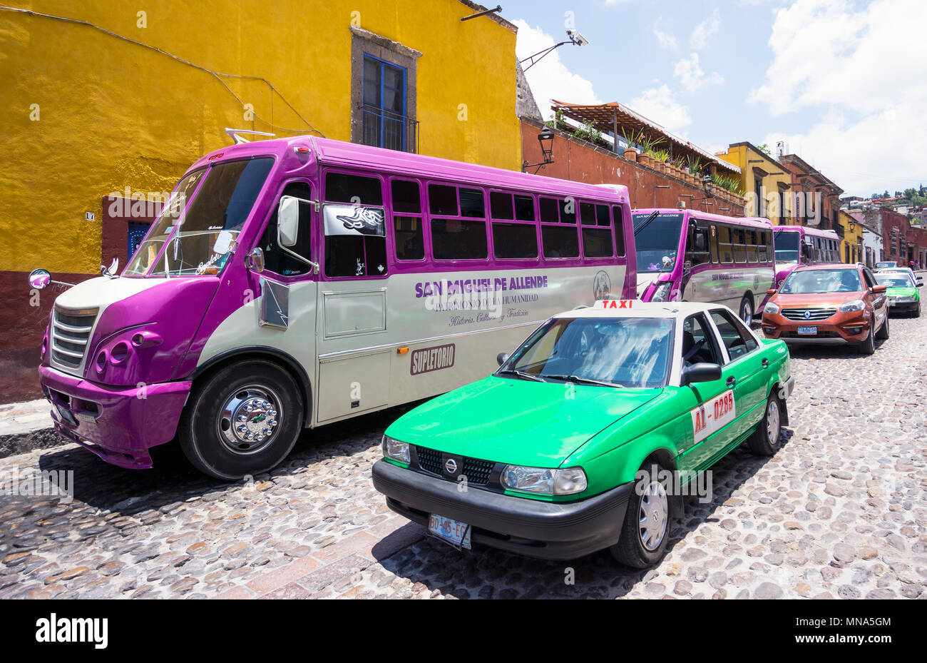 Various forms of transportation in San Miguel de Allende, Mexico: taxi, bus and private car. Stock Photo