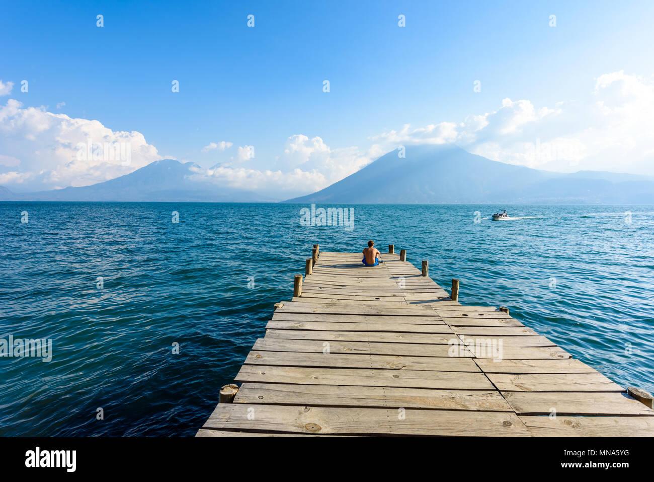 Pier at San Marcos La Laguna with beaufiful scenery of Lake Atitlan and volcanos - Guatemala - Stock Image