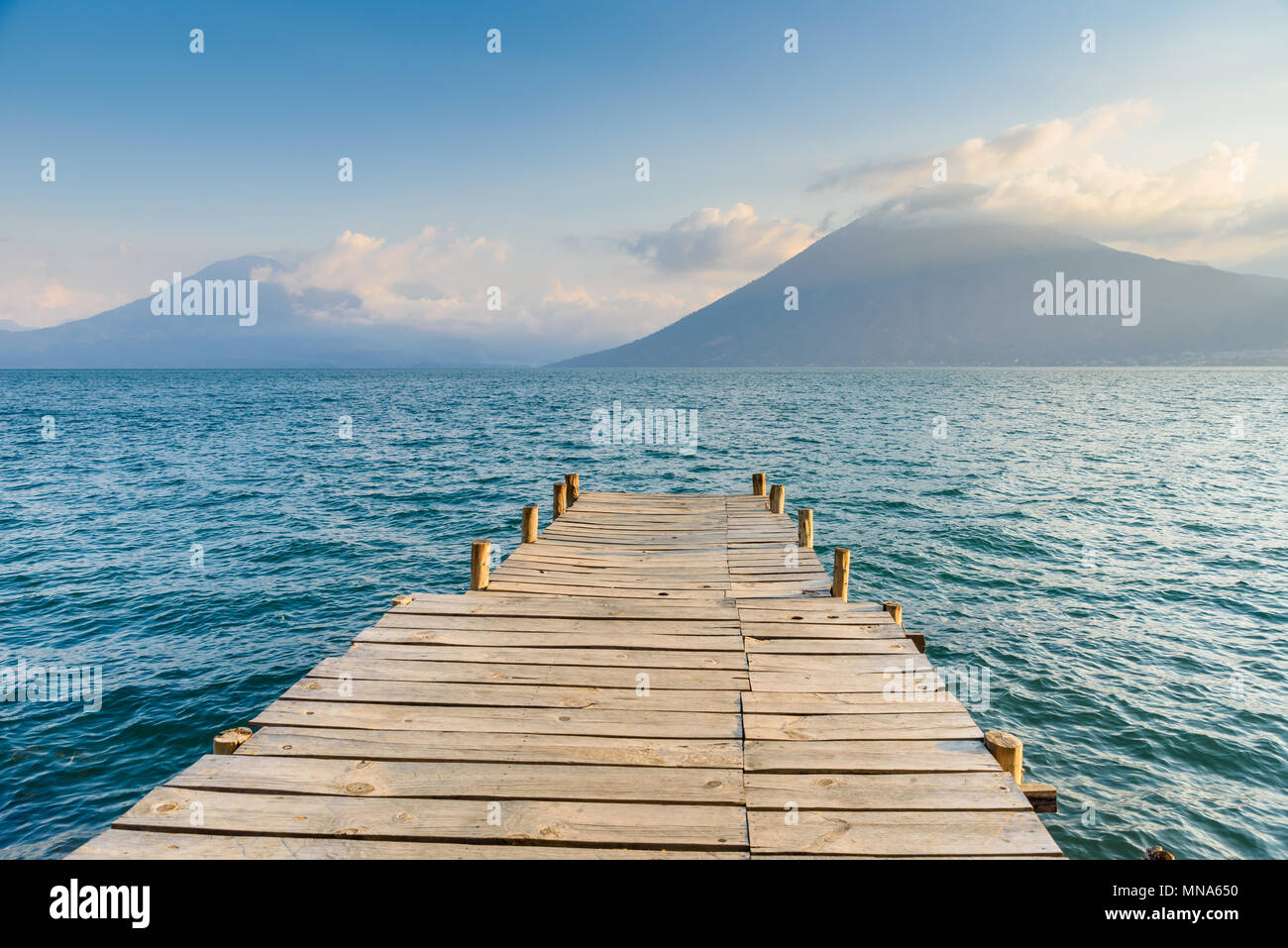 Pier at San Marcos La Laguna with beaufiful scenery of Lake Atitlan and volcanos - Guatemala - Stock Image