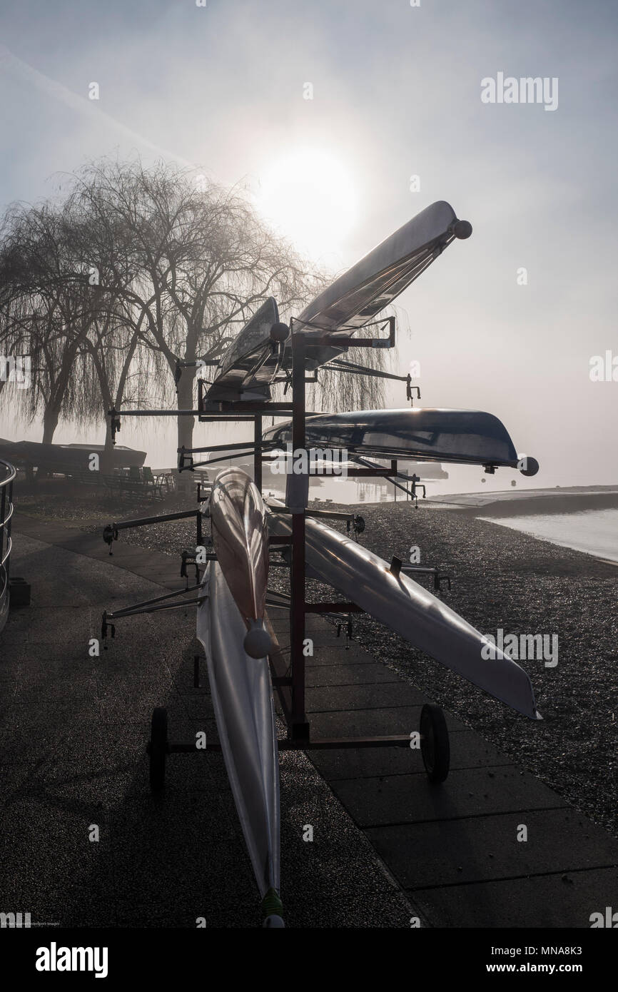 Varese. Lombardy. ITALY. General View. Mobile. Boat Rack. Sunrising, burning of the mist/fog at the Varese Rowing Club. [Canottieri Varese] Lake Vares - Stock Image
