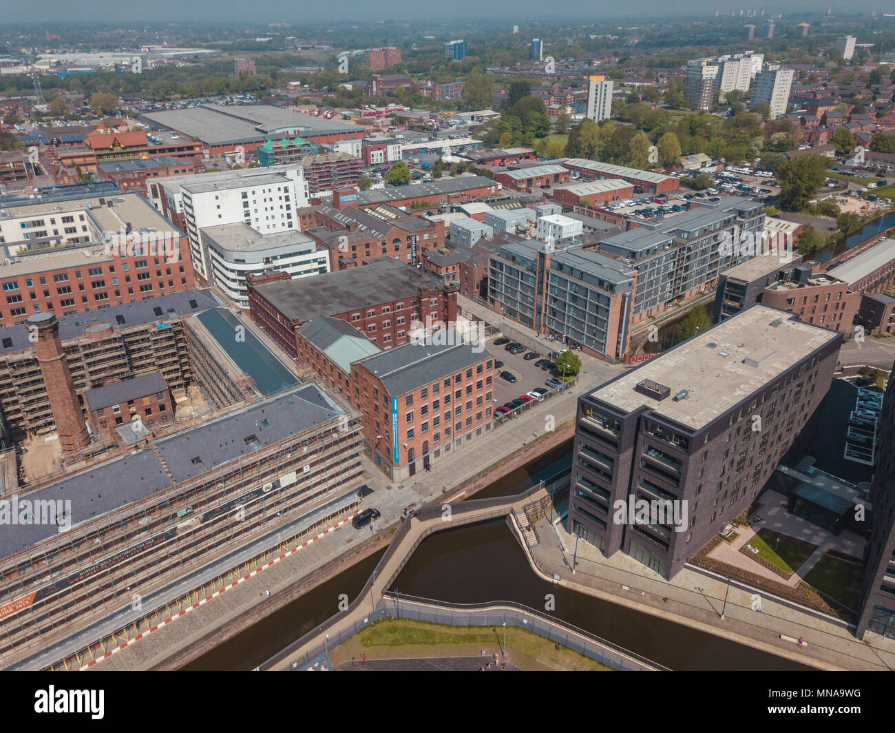 Manchester City Centre Drone Aerial View Above Building Work Skyline Construction Blue Sky Summer Deansgate - Stock Image