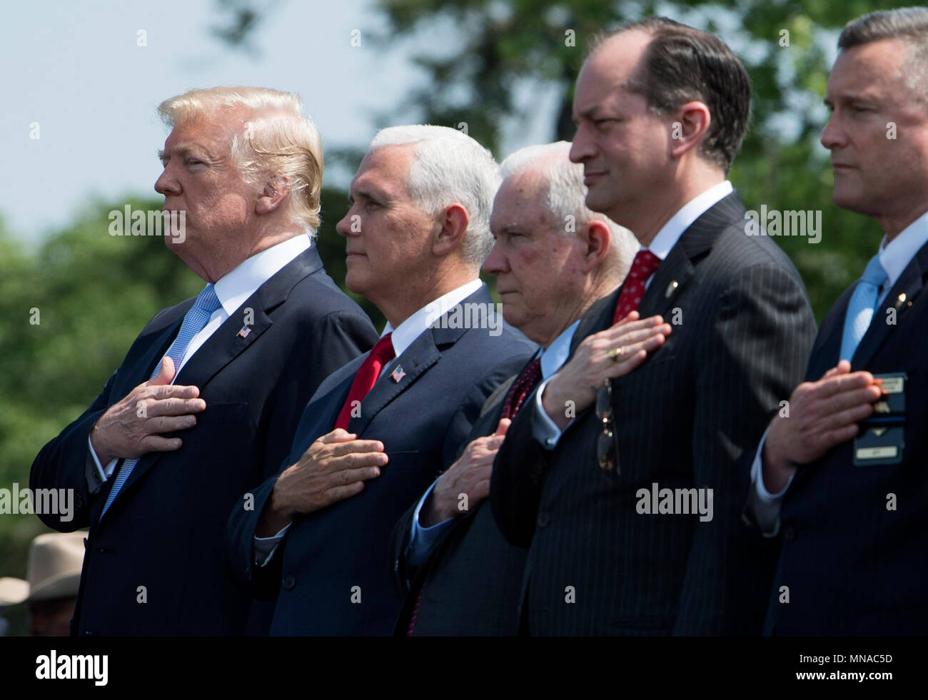 President Donald Trump (L), Vice President Mike Pence (2nd-L) Attorney General Jeff Sessions (3rd-L) and Health and Human Services Secretary Alex Azar stand for the national anthem during the 37th Annual National Peace Officers' Memorial Service at the U.S. Capitol Building on May 15, 2018 in Washington, D.C.  Credit: Kevin Dietsch / Pool via CNP | usage worldwide - Stock Image