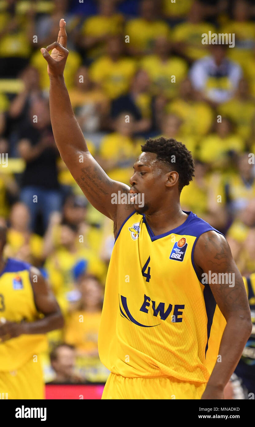 15 May 2018, Germany, Oldenburg: Bundesliga, EWE Baskets Oldenburg vs ALBA Berlin, championship round, quarter-final, in the EWE Arena. Oldenburg's Armani Moore celebrating after a score. Photo: Carmen Jaspersen/dpa - Stock Image